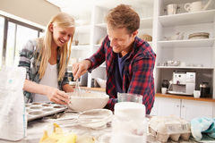Father and daughter making a cake together Stock Photos