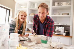 Father and daughter making a cake together Royalty Free Stock Photos
