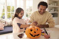 Father And Daughter Making Halloween Decorations At Home Royalty Free Stock Image