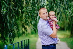 Father and daughter. man and beautiful little girl outdoors in park Stock Image