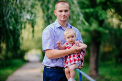 Father and daughter. man and beautiful little girl outdoors in park Royalty Free Stock Photos