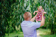 Father and daughter. man and beautiful little girl outdoors in park Royalty Free Stock Image