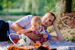 Father and daughter. man and beautiful little girl outdoors in park Stock Images