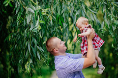 Father and daughter. man and beautiful little girl outdoors in park Royalty Free Stock Photography