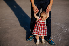 Father and daughter. man and beautiful little girl outdoors in park Stock Photos