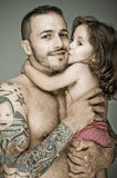 Father and daughter,  man with tattoo Stock Photos