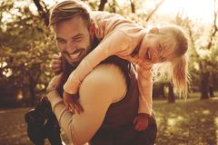 Father and daughter in meadow carrying her on shoulders. Single Father and daughter in meadow carrying her on shoulders royalty free stock photography