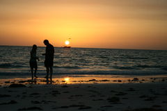 Father Daughter Moment. A father and his daughter share a moment searching for shells on the beach Stock Photography