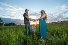 Father, daughter and mother walking outdoors Royalty Free Stock Photography