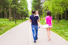 Father, daughter and mother walking outdoors. Happy family. Royalty Free Stock Photo