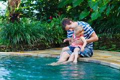 Father and daughter near swimming pool Stock Image