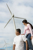 Father and daughter near wind turbines at wind farm Royalty Free Stock Image