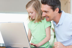 Father and daughter with notebook Royalty Free Stock Photo