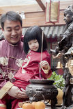 Father and daughter offering incense at the temple in Beijing Royalty Free Stock Photo