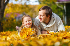 Father and daughter outdoors at autumn day Stock Photos