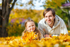Father and daughter outdoors at autumn day Royalty Free Stock Photography