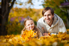 Father and daughter outdoors at autumn day royalty free stock photo