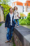 Father and daughter outdoors in a city Stock Photo