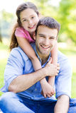 Father and daughter outdoors Stock Images