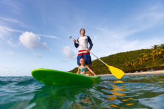 Father and daughter paddling Stock Image