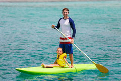 Father and daughter paddling Royalty Free Stock Images