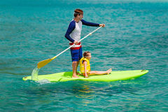 Father and daughter paddling Royalty Free Stock Image