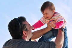Father and Daughter Parenting. Father plays and has fun with his baby daughter Stock Photo