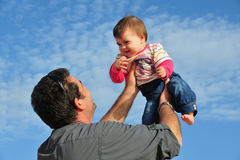 Father and Daughter Parenting. Father plays and has fun with his baby daughter Stock Photos