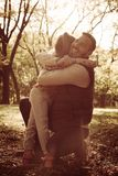 Father and daughter in park. Father and daughter hugging in park. Smiling day in nature stock photography