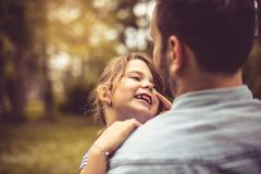 Father and daughter at park. royalty free stock image