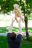 Father with daughter in park Stock Photo