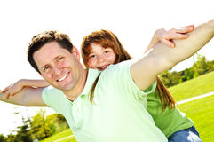 Father and daughter piggyback Royalty Free Stock Photo