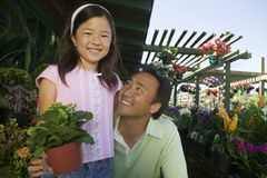 Father and Daughter in plant nursery portrait close up Royalty Free Stock Photos
