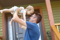 Father and daughter play in front of the house Royalty Free Stock Image