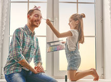 Father and daughter play royalty free stock images