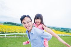 Father and daughter play happily stock photo