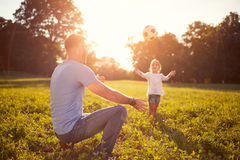 Father with daughter playing ball outdoor Stock Photos