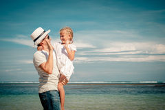 Father and daughter playing on the beach Stock Images
