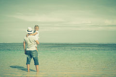 Father and daughter playing on the beach Royalty Free Stock Image