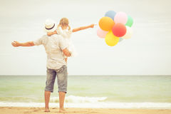 Father and daughter playing on the beach at the day time stock images