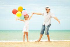 Father and daughter playing on the beach at the day time Royalty Free Stock Image