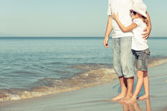 Father and daughter playing on the beach. Stock Photos