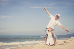 Father and daughter playing on the beach at the day time. Royalty Free Stock Photo