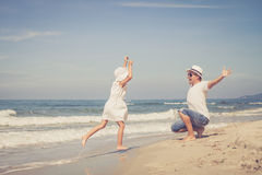 Father and daughter playing on the beach at the day time. Royalty Free Stock Images