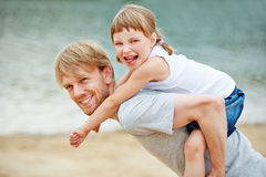 Father and daughter playing on beach Royalty Free Stock Image