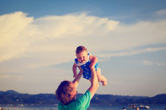 Father and daughter playing on beach Royalty Free Stock Photo