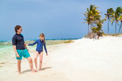 Father and daughter at beach. Father and daughter playing at beach on tropical Caribbean island stock photos