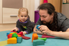 Father and daughter playing with bricks Stock Photos