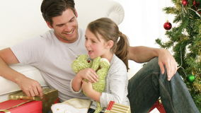 Father and daughter playing with Christmas gifts stock footage