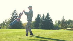 Father and daughter playing circling around at the park.
